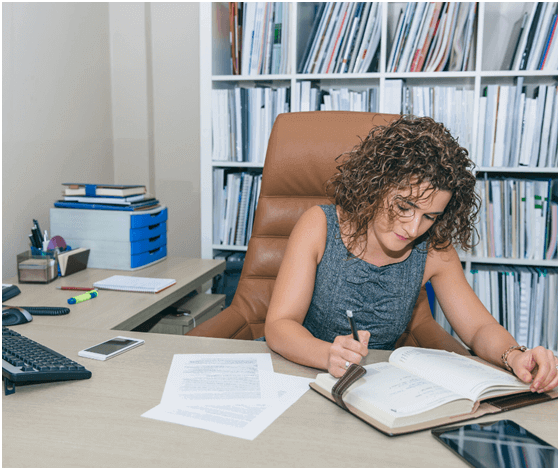 Woman writing on a desk
