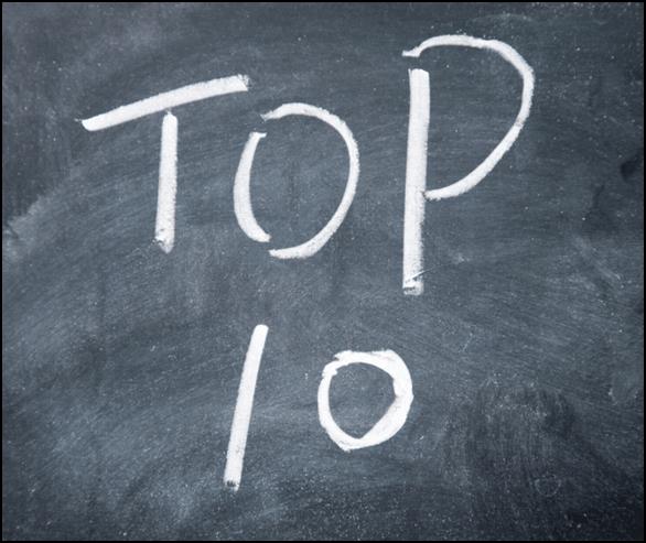 """: """"Top 10"""" written with white chalk on Blackboard"""